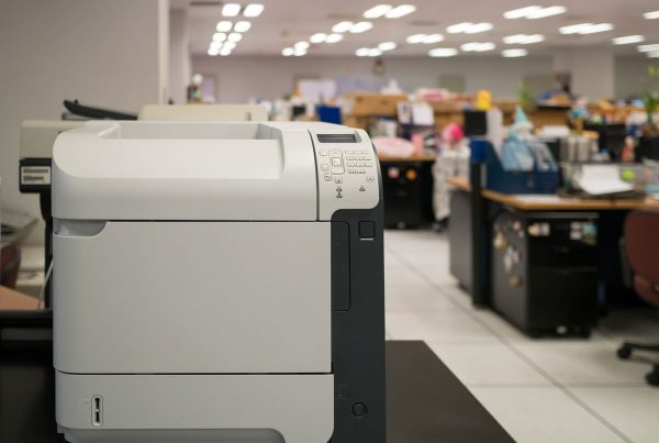 Multifunction printer sitting in a busy office