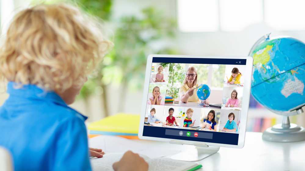 Remote classroom with child learning on tablet